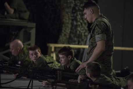 Lance Cpl. Luke Dailey, an indoor simulated marksmanship trainer with the Battle Skills Training School, operated by the 2nd Marine Logistics Group, helps a Canadian cadet diagnose a misfire at Camp Lejeune, N.C., March 15, 2016. A total of 46 cadets with the Argyll and Sutherland Highlanders of Canada Regimental Cadet Corps visited the base and multiple units as part of an educational tour to better understand of how foreign militaries function. (U.S. Marine Corps photo by Lance Cpl. Preston McDonald/Released)