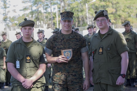 Cpl. Justin Zierer, an indoor simulated marksmanship trainer with the Battle Skills Training School, operated by the 2nd Marine Logistics Group, receives a plaque at Camp Lejeune, N.C., March 15, 2016. A total of 46 cadets with the Argyll and Sutherland Highlanders of Canada Regimental Cadet Corps visited the base and multiple units as part of an educational tour to better understand of how foreign militaries function. (U.S. Marine Corps photo by Lance Cpl. Preston McDonald/Released)