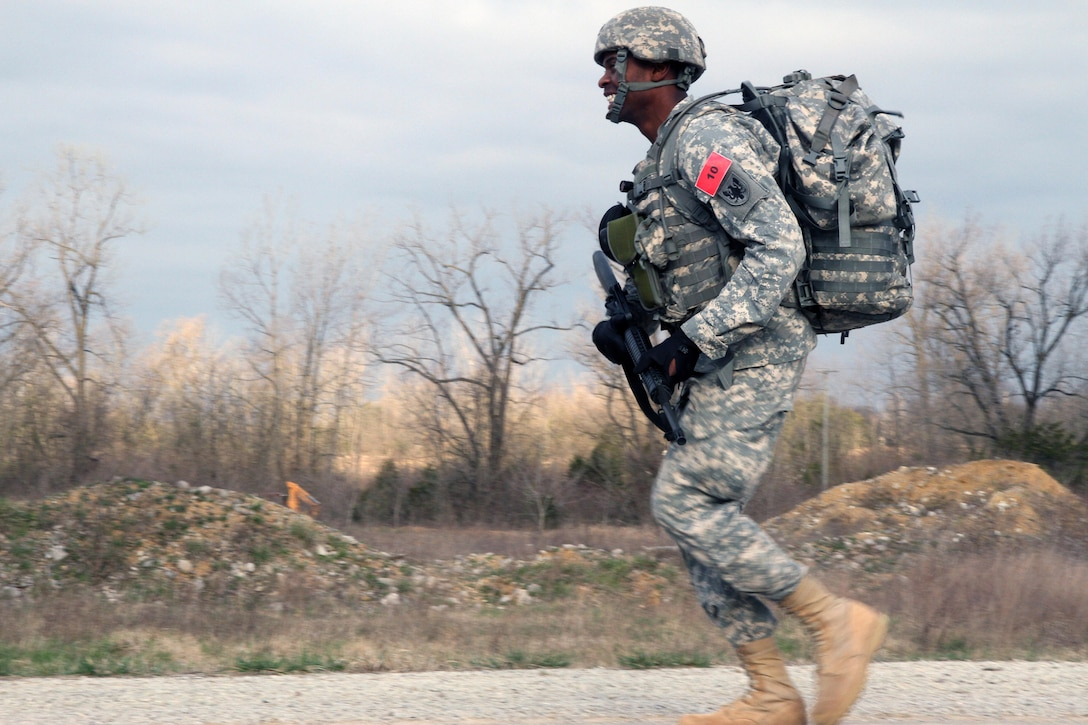 U.S. Army Reserve Spc. Jason McCord, 2nd Battalion, 58th Aviation Regiment, 11th Theater Aviation Command, takes off on a sprint during the Ruck March event of the 2016 Joint Best Warrior Competition on Fort Knox, Kentucky, March 23. 2016. (U.S. Army Photo by Clinton Wood/Released)