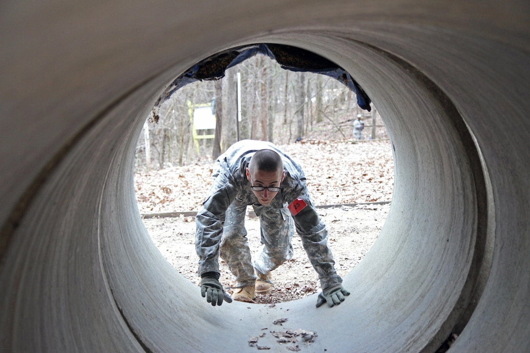 U.S. Army Reserve Spc. Steven McEown, 2nd Battalion, 311th Regiment, 78th Training Division, 84th Training Command (TC), crawls through a tunnel of the Beaudoin Obstacle Course during the 2016 Joint Best Warrior Competition on Fort Knox, Kentucky, March 23, 2016. (U.S. Army Photo by Clinton Wood/Released)