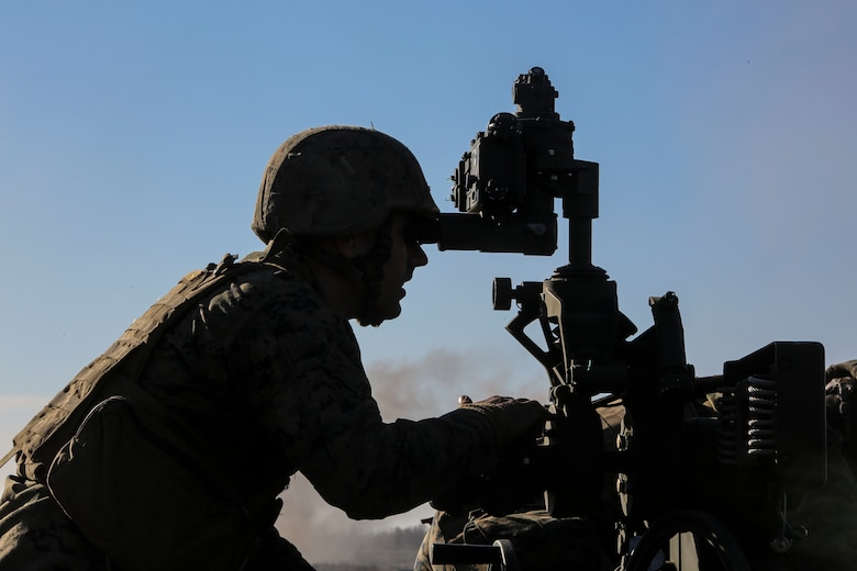 Cpl. Jesse Arthur, a field artillery cannoneer with 3rd Battalion, 14th Marine Regiment observes a firing position during a live-fire exercise as part of exercise Saipan Rain at Camp Lejeune, N.C., March 30, 2016. The battery, based out of Navy Operational Support Center, Richmond, Va., joined forces with 10th Marine Regiment to support operations during the exercise. (U.S. Marine Corps photo by Cpl. Paul S. Martinez/Released)