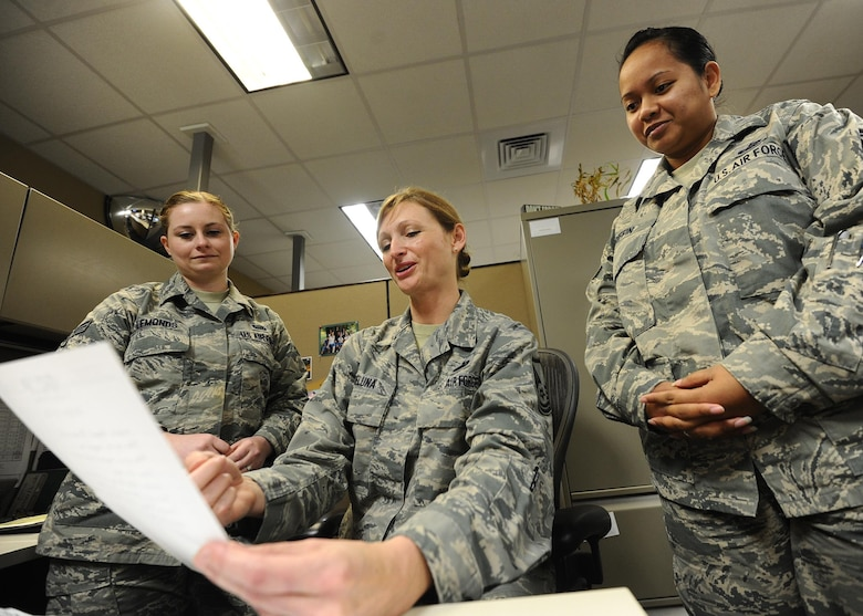Master Sgt. Tricia DeLuna, AFNORTH force management branch manager, reviews manpower documents with Senior Airman Charlott Lemonds, AFNORTH career development technician and Staff Sgt. Delayne Griffin, AFNORTH force management branch NCO in-charge, April 4 at the Killey Center for Homeland Operations. DeLuna, Lemonds and Griffin work within the A1-manpower and personnel section as well as manage all AFNORTH personnel related concerns.