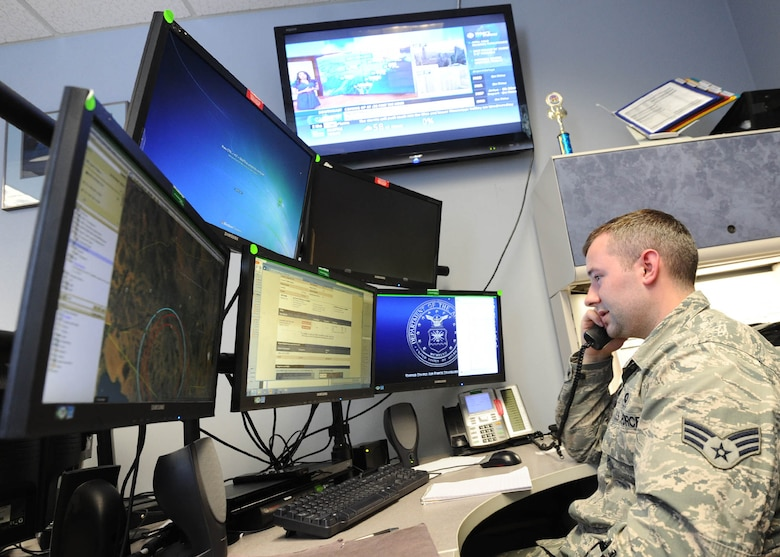 Senior Airman Dakota Powers, Air Force Rescue Coordination Controller, monitors computer screens while taking a phone call April 5 at the 601st Air Operations Center. The facility is staffed 24/7 to respond to, and coordinate rescue operations.