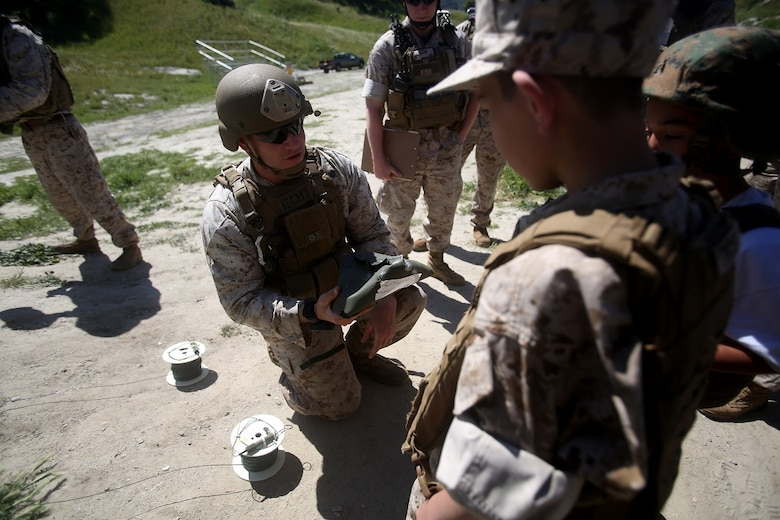 Nathan Aldaco, a 12 year-old boy with hypoplastic left heart syndrome, learns about the power of blasting caps during a Make-A-Wish event supported by 7th Engineer Support Battalion, 1st Marine Logistics Group, aboard Camp Pendleton, Calif., March 24, 2016. Marines with 7th ESB and Explosive Ordnance Disposal helped to make Nathan's wish of becoming a Marine come true by demonstrating the capabilities of their EOD robots and detonating TNT, C4, dynamite and blasting caps, while the heavy equipment operators gave him the opportunity to ride the D7 dozer and the excavator, in which he dug a pit, built a berm, and broke several large tree trunks.  (U.S. Marine Corps photo by Sgt. Laura Gauna/released)
