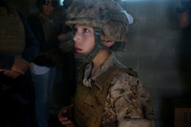 Nathan Aldaco, a 12 year-old boy with hypoplastic left heart syndrome, gets a safety brief before watching explosives detonate during a Make-A-Wish event supported by 7th Engineer Support Battalion, 1st Marine Logistics Group, aboard Camp Pendleton, Calif., March 24, 2016. Marines with 7th ESB and Explosive Ordnance Disposal helped to make Nathan's wish of becoming a Marine come true by demonstrating the capabilities of their EOD robots and detonating TNT, C4, dynamite and blasting caps, while the heavy equipment operators gave him the opportunity to ride the D7 dozer and the excavator, in which he dug a pit, built a berm, and broke several large tree trunks.  (U.S. Marine Corps photo by Sgt. Laura Gauna/released)