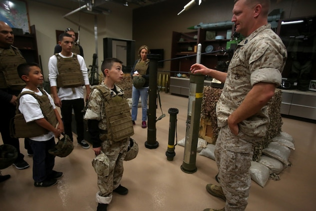 Nathan Aldaco, a 12 year-old boy with hypoplastic left heart syndrome, learns about explosive ordnance during a Make-A-Wish event supported by 7th Engineer Support Battalion, 1st Marine Logistics Group, aboard Camp Pendleton, Calif., March 24, 2016. Marines with 7th ESB and Explosive Ordnance Disposal helped to make Nathan's wish of becoming a Marine come true by demonstrating the capabilities of their EOD robots and detonating TNT, C4, dynamite and blasting caps, while the heavy equipment operators gave him the opportunity to ride the D7 dozer and the excavator, in which he dug a pit, built a berm, and broke several large tree trunks.  (U.S. Marine Corps photo by Sgt. Laura Gauna/released)