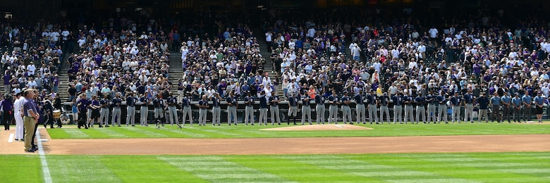The Colorado Rockies held a military appreciation day April 8, 2016, during pre-game festivities at Coors Field in Denver, Colo. All branches of the military and the community's civil servants, to include the police department and the county sheriff's office, attended and participated in the day-long event. The ceremony included a joint color guard and a flag held by those in uniform. (U.S. Air Force photos by Airman 1st Class Gabrielle Spradling/Released)