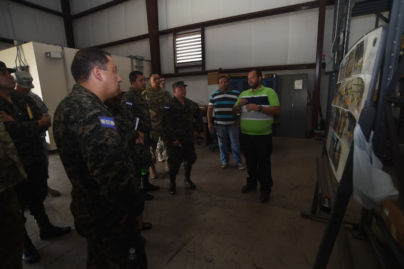 Mr. Ivis Valenzuela, Supply Support Activity, provides a brief to members of the Honduran Logistics Command (CALFA), Soto Cano Air Base, Honduras, April 1, 2016, about SSA tactical operations. Col. Rodriguez, new CALFA Commander, and 6 of his staff visited Soto Cano Air Base to learn about ARFOR's mission and build partnerships that could lead to executing combined and joined training with JTF-Bravo. (U.S. Army photo by Martin Chahin/RELEASED)