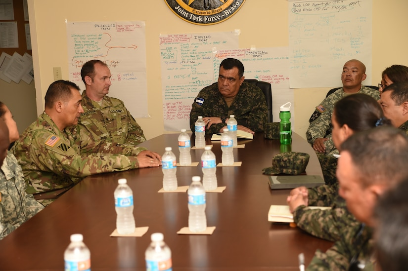 U.S. Army Major Hernando Bello, Army Forces Battalion, provides a brief on the battalion's mission for Honduran Col. José Antonio Rodriguez Mencia (center), and to members of the Honduran Logistics Command (CALFA), at Soto Cano Air Base, Honduras, April 1, 2016. Col. Rodriguez, new CALFA Commander, and six of his staff visited Soto Cano Air Base to learn about some of the logistical support mechanisms available to ARFOR and Joint Task Force-Bravo.  (U.S. Army photo by Martin Chahin/UNRELEASED)