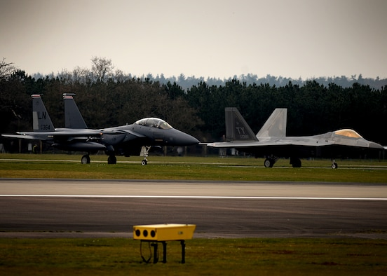 F-22 Raptors from the 95th Fighter Squadron land April 11, at Royal Air Force Lakenheath,  England. The aircraft arrival marks the second time the U.S. European Command has hosted a deployment of F-22 aircraft in the EUCOM Area of Responsibility.  (U.S. Air Force photo/ Tech. Sgt. Matthew Plew)