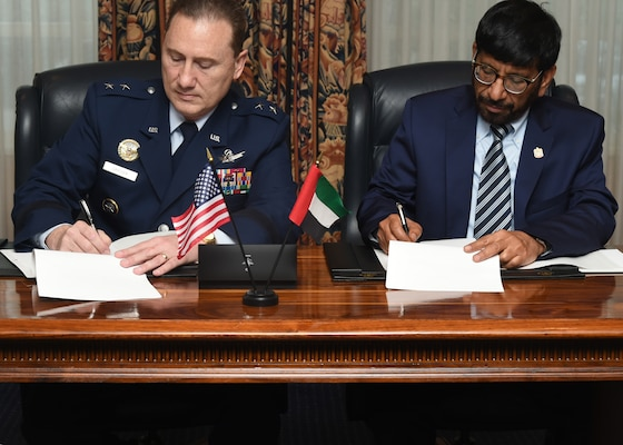 U.S. Air Force Maj. Gen. Clinton E. Crosier, U.S. Strategic Command (USSTRATCOM) director of plans and policy (left), and His Excellency, Dr. Khalifa Al Romaithi, United Arab Emirates Space Agency (UAESA) chairman, sign a memorandum of understanding (MOU) at the Broadmoor Hotel in Colorado Springs, Colo., April 11, 2016. The MOU to share space situational awareness (SSA) services and information, signed during the 32nd Space Symposium, will enhance awareness within the space domain and increase the safety of spaceflight operations for the U.S. and UAE. The UAE joins 10 nations, two intergovernmental organizations, the European Space Agency and the European Organization for the Exploitation of Meteorological Satellites, and more than 50 commercial satellite owner/operator/launchers already participating in SSA data-sharing agreements with USSTRATCOM. SSA data-sharing agreements enhance multinational space cooperation and streamline the process for USSTRATCOM partners to request specific information gathered by USSTRATCOM's Joint Space Operations Center at Vandenberg Air Force Base, Calif. One of nine DoD unified combatant commands, USSTRATCOM has global strategic missions, assigned through the Unified Command Plan, which include strategic deterrence; space operations; cyberspace operations; joint electronic warfare; global strike; missile defense; intelligence, surveillance and reconnaissance; combating weapons of mass destruction; and analysis and targeting. (U.S. Air Force photo by Senior Airman William Branch)