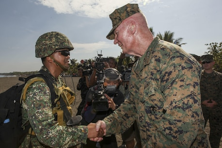 "U.S. Marine Corps Lt. Gen. John A. Toolan, commander of the U.S. Marine Corps Forces, Pacific, greets a Philippine marine, member of the Joint Rapid Reaction Force (JRRF), after executing an amphibious landing to seize a scenario-based objective as part of Exercise Balikatan 2016, in Antique, Philippines, April 11, 2016. The JRRF, compiled of U.S. and Philippine forces, have worked together during the exercise to test their capabilities, maintain a high level of interoperability and to enhance combined combat readiness. Balikatan, which means ""shoulder to shoulder"" in Filipino, is an annual bilateral training exercise aimed at improving the ability of Philippine and U.S. military forces to work together during planning, contingency and humanitarian assistance and disaster relief operations."