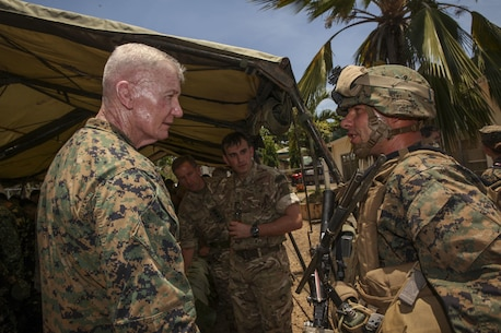 """U.S. Marine Corps Lt. Gen. John A. Toolan, commander of the U.S. Marine Corps Forces, Pacific, greets a U.S. Marine assigned to 2nd Battalion, 2nd Marine Regiment, II Marine Expeditionary Force, member of the Joint Rapid Reaction Force (JRRF), after executing an amphibious landing to seize a scenario-based objective as part of Exercise Balikatan 2016, in Antique, Philippines, April 11, 2016. The JRRF, compiled of U.S. and Philippine forces, have worked together during the exercise to test their capabilities, maintain a high level of interoperability and to enhance combined combat readiness. Balikatan, which means """"shoulder to shoulder"""" in Filipino, is an annual bilateral training exercise aimed at improving the ability of Philippine and U.S. military forces to work together during planning, contingency and humanitarian assistance and disaster relief operations."""