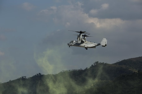 """U.S. and Philippine Marines fly in a MV-22B Osprey to their drop off zone during Balikatan 16, at Crow Valley, Philippines, April 9, 2016. U.S. and Philippine Marines trained """"shoulder-to-shoulder"""" after an aerial insert in ground assault maneuvers to build their combined capabilities. Balikatan is an annual Philippines-U.S. military bilateral training exercise that strengthens the Philippine-U.S. alliance and focuses on a variety of missions in response to conflict and crises throughout the Indo-Asia-Pacific region. (U.S. Marine Corps photo by Lance Cpl. Cameron Darrough/Released)"""