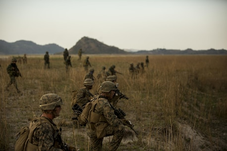 """U.S. and Philippine Marines conducts a ground assault maneuver during Balikatan 16, at Crow Valley, Philippines, April 9, 2016. U.S. and Philippine Marines trained """"shoulder-to-shoulder"""" after an aerial insert in ground assault maneuvers to build their combined capabilities. Balikatan is an annual Philippines-U.S. military bilateral training exercise that strengthens the Philippine-U.S. alliance and focuses on a variety of missions in response to conflict and crises throughout the Indo-Asia-Pacific region. (U.S. Marine Corps photo by Lance Cpl. Cameron Darrough/Released)"""