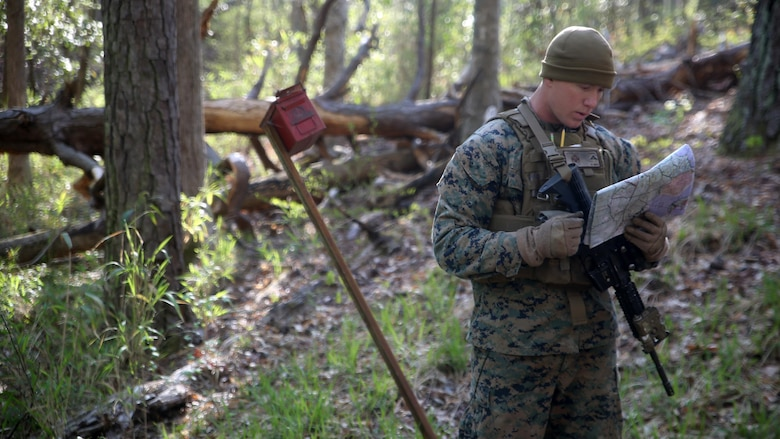 Lance Cpl. Silas F. Lewis, a scout with 2nd Light Armored Reconnaissance Battalion, reviews his map during the land navigation portion of the battalion's annual Isaak Competition at Camp Lejeune, N.C., April 6, 2016. The competition offered the scouts a plethora of different scenarios a scout must be able to accomplish, including casualty evacuation, call for fire, unknown-distance marksmanship, and land navigation. (U.S. Marine Corps photo by Cpl. Joey Mendez)
