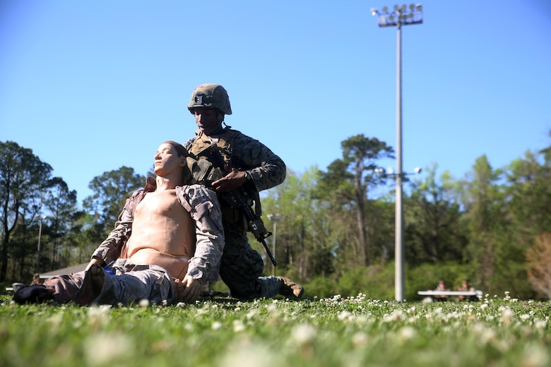 A scout with 2nd Light Armored Reconnaissance Battalion demonstrates his abilities in combat lifesaver skills during the battalion's annual Isaak Competition at Camp Lejeune, N.C., April 4, 2016. The competition offered the scouts a plethora of different scenarios a scout must be able to accomplish, including casualty evacuation, call for fire, unknown-distance marksmanship, and land navigation. (U.S. Marine Corps photo by Cpl. Joey Mendez)