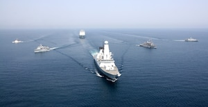 (April 11, 2016) Royal Navy ship HMS Defender and Royal Fleet Auxiliary ship RFA Cardigan Bay anchor a formation of coalition mine countermeasures and maritime security vessels at sea, operating in support of the International Mine Countermeasures Exercise (IMCMEX). IMCMEX includes navies from more than 30 countries spanning six continents training together across the Middle East. The exercise is focused on maritime security from mine countermeasures, maritime infrastructure protection and maritime security operations in support of civilian shipping.