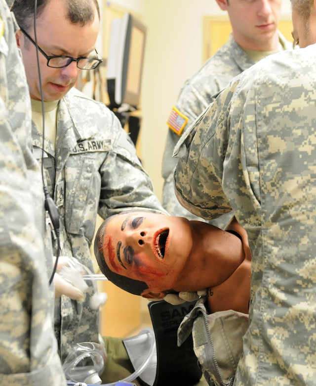 U.S. Army Reserve Soldiers with the 399th Combat Support Hospital, 804th Medical Brigade, 3d Medical Command (Deployment Support), performs a physical assessment on a simulated casualty during an exercise held April 2, 2016 at the Mayo Clinic Multidisciplinary Simulation Center in Rochester, Minnesota. During the exercise, the unit implemented the Team Strategies and Tools to Enhance Performance and Patient Safety, or TeamSTEPPS, model of patient care. The model serves as a framework to optimize team performance across the health care delivery system.