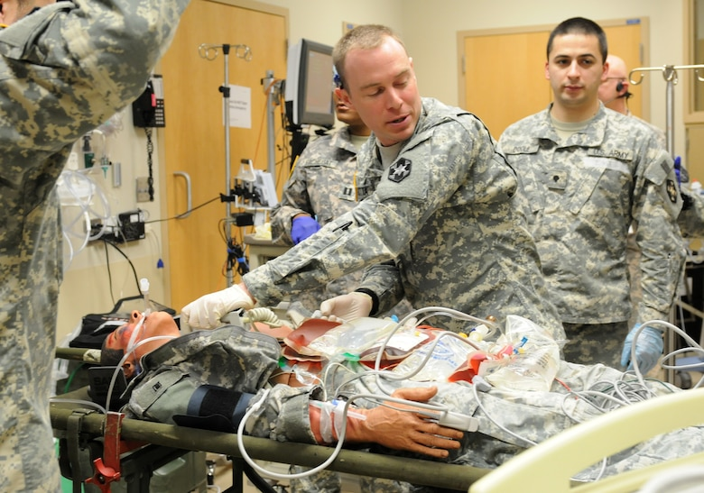 U.S. Army Reserve 1st Lt. John Gotta, a South Kingstown, Rhode Island native and emergency room nurse with the 399th Combat Support Hospital, 804th Medical Brigade, 3d Medical Command (Deployment Support) makes sure it is clear before delivering a shock to a simulated casualty during an exercise held April 2, 2016 at the Mayo Clinic Multidisciplinary Simulation Center in Rochester, Minnesota. The purpose of the exercise was for the 399th CSH Soldiers to practice the Department of the Defense mandated framework known as Team Strategies and Tools to Enhance Performance and Patient Safety, or TeamSTEPPS. TeamSTEPPS optimizes military medical care by focusing on reducing communication errors that can lead to improper patient care.