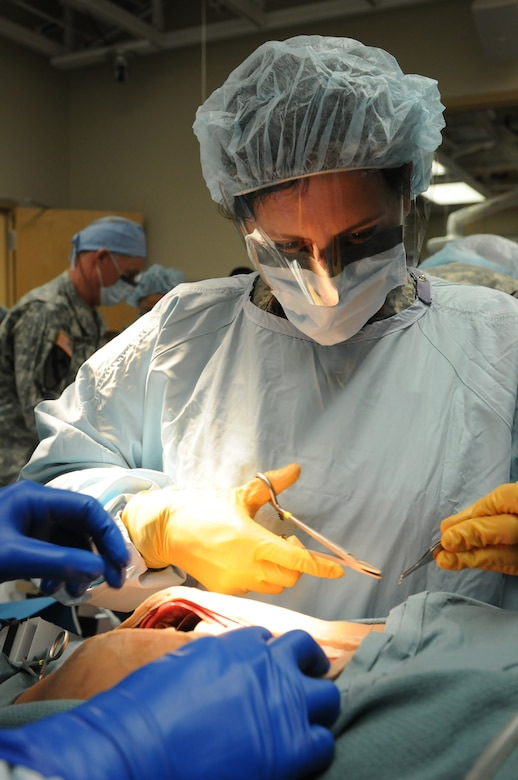 U.S. Army Reserve Sgt. Fuada Kasollja, a Dedham, Massachusetts native and operating room technician with the 399th Combat Support Hospital, 804th Medical Brigade, 3d Medical Command (Deployment Support) sutures a simulated patient during an exercise April 2, 2016 at the Mayo Clinic Multidisciplinary Simulation Center in Rochester, Minnesota. The purpose of the exercise was for the 399th CSH Soldiers to practice the Department of the Defense mandated framework known as Team Strategies and Tools to Enhance Performance and Patient Safety, or TeamSTEPPS. TeamSTEPPS optimizes military medical care by focusing on reducing communication errors that can lead to improper patient care.