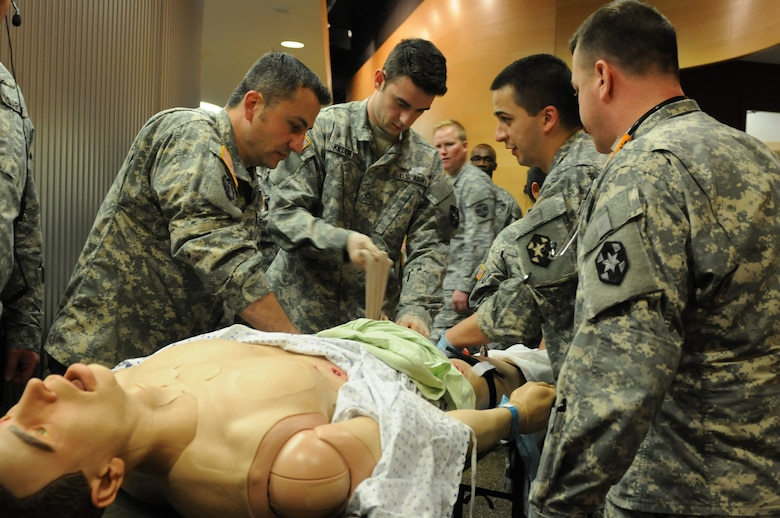 A team of Soldiers from the 399th Combat Support Hospital, 804th Medical Brigade, 3d Medical Command (Deployment Support) apply interventions to a simulated patient during an exercise April 2, 2016 at the Mayo Clinic Multidisciplinary Simulation Center in Rochester, Minnesota. During the exercise, the unit, which is based out of Fort Devens, Massachusetts., practiced the Team Strategies and Tools for Enhanced Performance and Patient Safety, or TeamSTEPPS, model of patient care. TeamSTEPPS is a framework implemented by the Department of Defense to optimize performance of military medical teams and reduce communication errors that can lead to improper patient care.