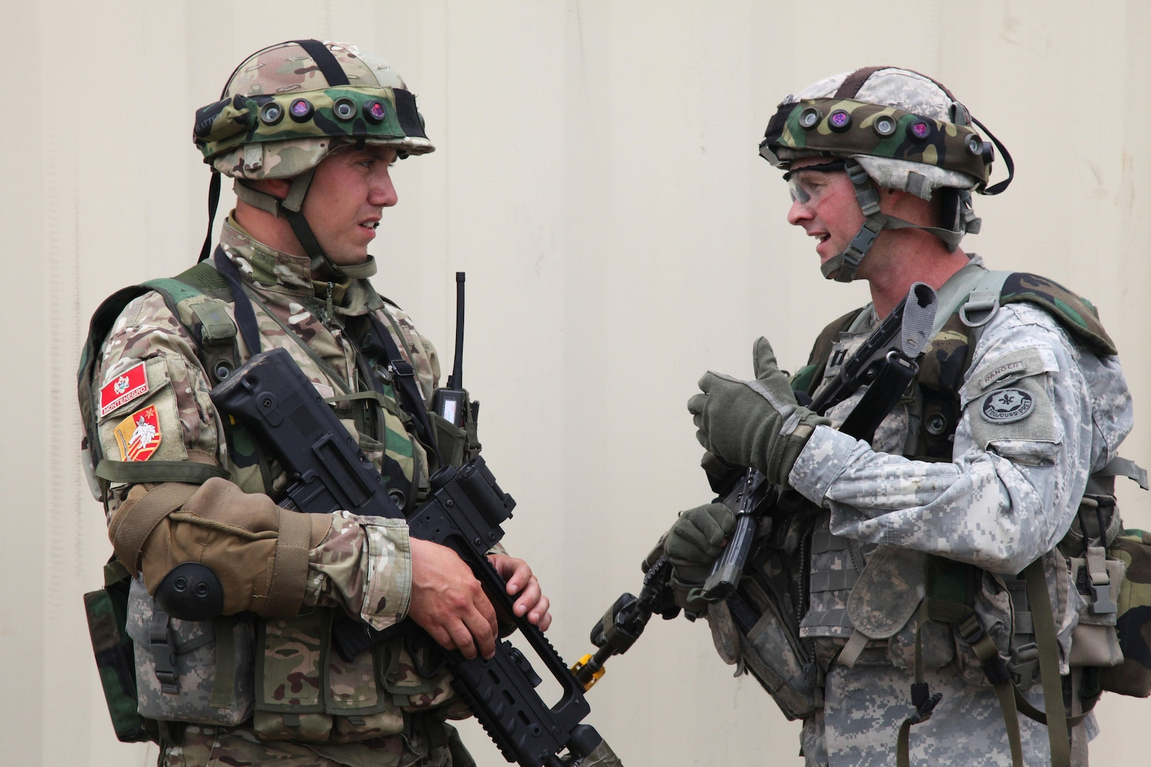 U.S. Army Capt. Geoffrey Lynch, right, the headquarters commander with the 2nd Cavalry Regiment, discusses operations and tactics with Montenegrin army Lt. Ratko Cosovic after a field training exercise during the Immediate Response 2012 training event in Slunj, Croatia, June 5, 2012. Immediate Response is a U.S. Army Europe-led combined joint tactical field training exercise designed to build interoperability between NATO, Croatia and its regional partner nations. (DoD photo by Spc. Lorenzo Ware, U.S. Army/Released)