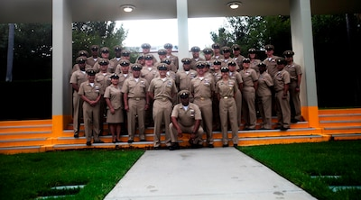 Chief Petty Officers with 1st Medical Battalion, 1st Marine Logistics Group, pose for a picture during the U.S. Navy Chief Petty Officer 123rd birthday cake-cutting ceremony aboard Camp Pendleton, Calif. April 1, 2016. The battalion provides health service support to the operating units of I Marine Expeditionary Force to reach full mission accomplishment. (U.S. Marine Corps photo by Sgt. Laura Gauna/released)