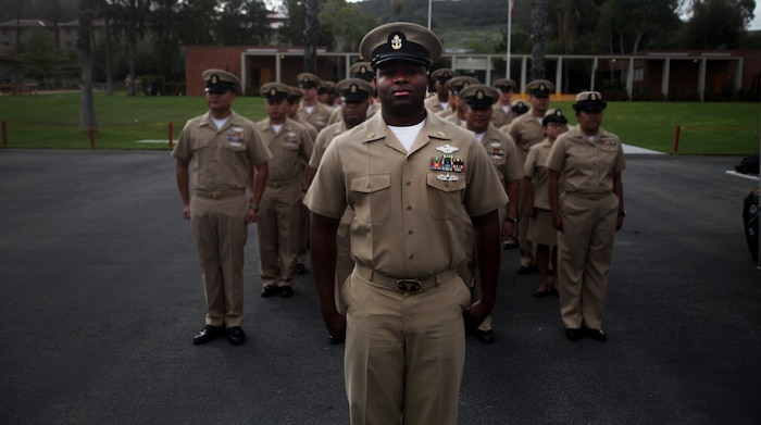 U.S. Navy Chief Petty Officer Mario Lyons stands at attention during the U.S. Navy Chief Petty Officer 123rd birthday cake-cutting ceremony aboard Camp Pendleton, Calif. April 1, 2016. Lyons is a senior enlisted leader with Alpha Surgical Company, 1st Medical Battalion, 1st Marine Logistics Group. The battalion provides health service support to the operating units of I Marine Expeditionary Force to reach full mission accomplishment. (U.S. Marine Corps photo by Sgt. Laura Gauna/released)