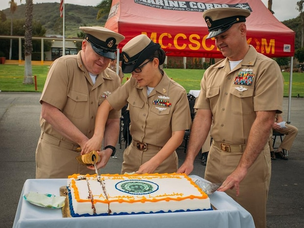 The youngest and oldest chief petty officers of 1st Medical Battalion, 1st Marine Logistics Group, cut into a ceremonial cake to celebrate the U.S. Navy Chiefs 123rd birthday aboard Camp Pendleton, Calif., April 1, 2016. The battalion provides health service support to the operating units of I Marine Expeditionary Force to reach full mission accomplishment. (U.S. Marine Corps photo by Sgt. Laura Gauna/released)