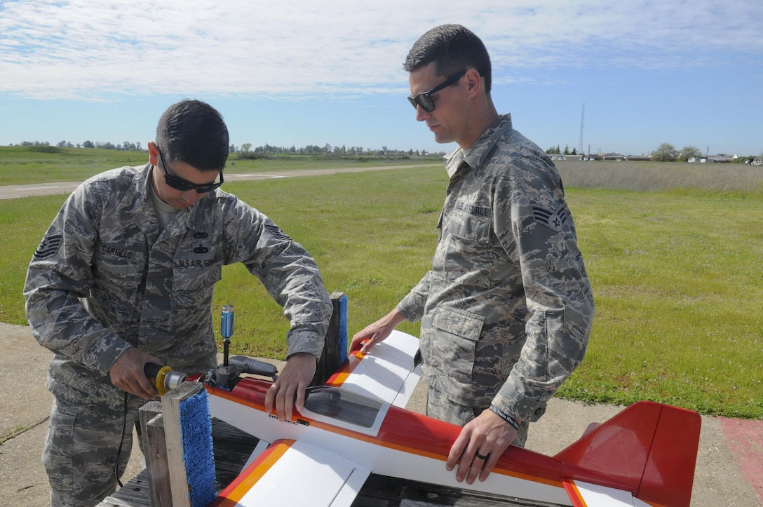 Tech. Sgt. Michael Carrillo (left) and Senior Airman Justin Joyner, 349th Air Mobility Wing Detachment 1 KC-135 crew chiefs, prep a radio-controlled plane for flight at Beale Air Force Base, California March 25, 2016. Carrillo is a member of the Beale Blackbirds Radio Control Club. (U.S. Air Force photo by Senior Airman Michael J. Hunsaker)