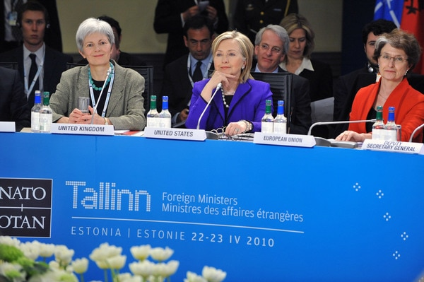 U.S. Secretary of State Hillary Rodham Clinton, sits between Mariot Leslie, Permanent Representative of the United Kingdom to NATO, (left) and and Claude-France Arnould, Deputy Director, EU Crisis Management and Planning Directorate, (right) at the NATO Foreign Ministers Meeting in Tallinn, Estonia, April 22, 2010. [NATO Photo/Public Domain]