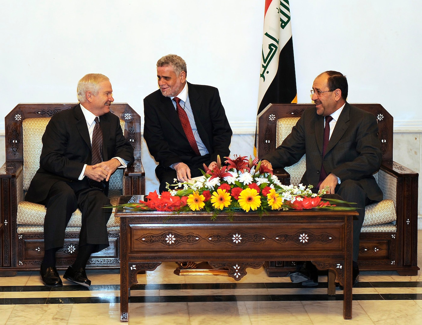 Secretary of Defense Robert M. Gates, left, talks with Iraqi Prime Minister Nouri al-Maliki, right, during a meeting in Baghdad, Iraq, Dec. 11, 2009. (DoD photo by Master Sgt. Jerry Morrison, U.S. Air Force/Released)