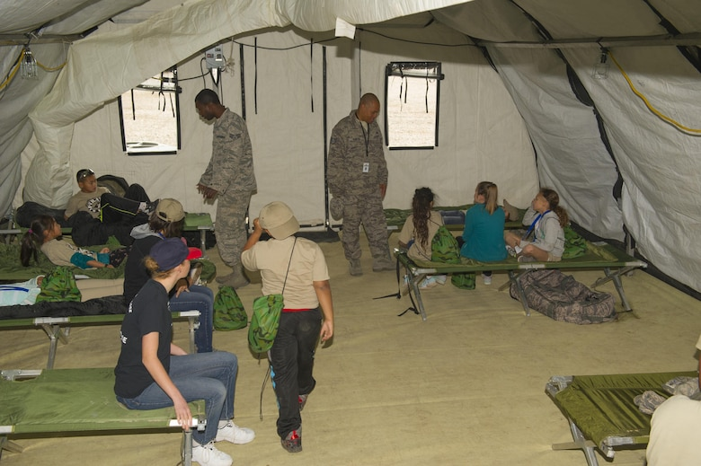 Children listen to a briefing about living out of tents during Operation K.I.D. (Kids Investigating Deployment), April 8 at Holloman Air Force Base, N.M. Each year, the Airmen and Family Readiness Center and the Youth Center host Operation K.I.D. in April, the Month of the Military Child. The A&FRC believes that it is important for children to experience what their parents go through during a deployment.