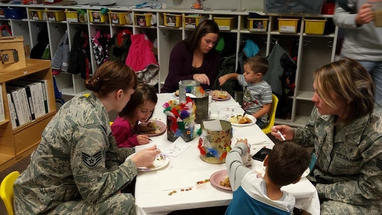 Staff Sgt. Shannon Olson, left, 28th Bomb Wing chaplain assistant, spends time with children in the Youth Center at Ellsworth Air Force Base, S.D., Nov. 19, 2015. Parents were invited to the center for a special event to celebrate Thanksgiving with their children. (Courtesy photo by Staff Sgt. Shannon Olson/Released)