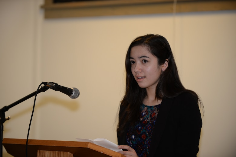"""Ria Gualano, daughter of Lan Gualano, 28th Comptroller Squadron quality assurance manager, gives a speech against bullying to military children during an """"In Their Shoes"""" parade at Ellsworth Air Force Base, S.D., April 6, 2016. Ria was named the South Dakota Military Youth of the Year in March and aims to win the national to spread a positive message to inspire youth across the country. (U.S. Air Force photo by Airman 1st Class Sadie Colbert/Released)"""