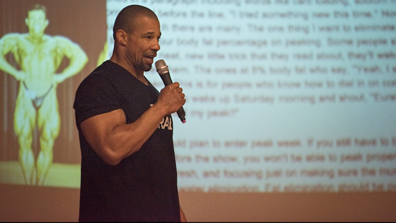 Philip Ricardo, Jr., Mr. Olympia Natural award winner, speaks to a group of service members about his lifestyle April 2, 2016 at Joint Base McGuire-Dix-Lakehurst, N.J. During the seminar, he discussed fitness, healthy eating and overcoming challenges. (U.S. Air Force photo by Staff Sgt. Katherine Tereyama)