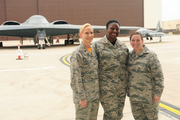 """Maj. Kellie Courtland, left, 509th Logistics Readiness Squadron commander, Maj. Redahlia Person, center, 509th Maintenance Squadron commander, and Maj. Catherine Tredway, 509th Force Support Squadron commander, stand in front of 509th Bomb Wing B-2 Spirit and T-38 Talon aircraft July 24, 2015 at Whiteman Air Force Base, Mo. March is Women's History Month (WHM), and the trio represent the 2016 WHM theme, """"Working to Form a More Perfect Union: Honoring Women in Public Service and Government (U.S. Air Force photo by Airman 1st Class Jazmin Smith)"""