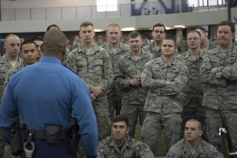 An Alaska State Trooper officer explains the consequences of drinking and driving to members of the 354th Fighter Wing April 8, 2016, on Eielson Air Force Base, Alaska. The event had four stations offering an educational look at the various effects alcohol has on the body and ultimately an Airman's career. (U.S. Air Force photo by Staff Sgt. Joshua Turner/Released)
