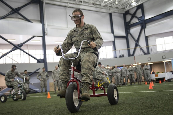 U.S. Air Force Staff Sgt. James Culver, a 354th Civil Engineer Squadron, Heating, Ventilation and Air Conditioning technician, rides a tricycle while wearing beer goggles April 8, 2016, on Eielson Air Force Base, Alaska. Eielson's Alcohol and Drug Abuse Prevention and Treatment team offered hands-on experiences demonstrating how the body reacts while inebriated. (U.S. Air Force photo by Staff Sgt. Joshua Turner/Released)
