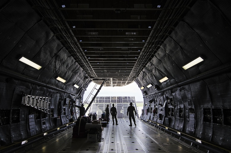 Reserve loadmasters from the 709th Airlift Squadron, Dover Air Force Base, Del., open the nose door of a C-5M Super Galaxy March 30, 2016, at Wright Patterson Air Force Base, Ohio, before loading equipment and flying to an off-station training exercise at Naval Air Station Pensacola, Fla. Dover reservists from 14 different career fields trained in mission readiness and combat related areas March 29 through April 3 to ensure they are current in all their deployment requirements. (U.S. Air Force photo/Capt. Bernie Kale)