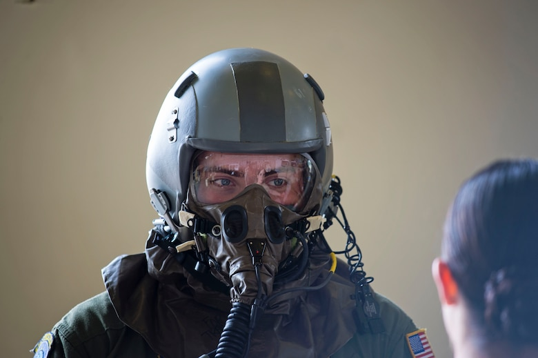 Senior Airman Jake Voshell, a loadmaster with the 709th Airlift Squadron, receives instruction from Staff Sgt. Brittany Toth, from the 436th Airlift Wing, on how to execute the mission in a simulated chemically hazardous area, April 1, 2016, at Naval Air Station Pensacola, Fla. Aircrews from Dover Air Force Base, Del., in the 512th Airlift Wing, conducted an off-station training exercise March 29 through April 3 to ensure they are current in all their deployment requirements. (U.S. Air Force photo/Capt. Bernie Kale)