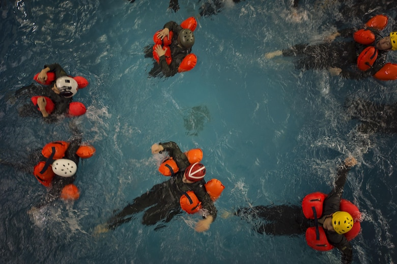 Aircrew from the 709th Airlift Squadron tread water during their water survival portion of their recurring training, April 1, 2016, at Naval Air Station Pensacola, Fla. Reservists from Dover Air Force Base, Del., in the 512th Airlift Wing, conducted an off-station training exercise March 29 to April 3 to ensure they are current in all their deployment requirements. (U.S. Air Force photo/Capt. Bernie Kale)