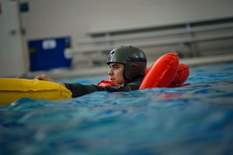 Tech. Sgt. Richard Claycomb, a flight engineer with the 709th Airlift Squadron, hangs on to the life raft during water survival training, April 1, 2016, in Pensacola, Fla. Reservists from Dover Air Force Base, Del., in the 512th Airlift Wing, conducted an off-station training exercise at Naval Air Station Pensacola, Fla., March 29 through April 3 to ensure they are current in all their deployment requirements. (U.S. Air Force Photo/Capt. Bernie Kale)