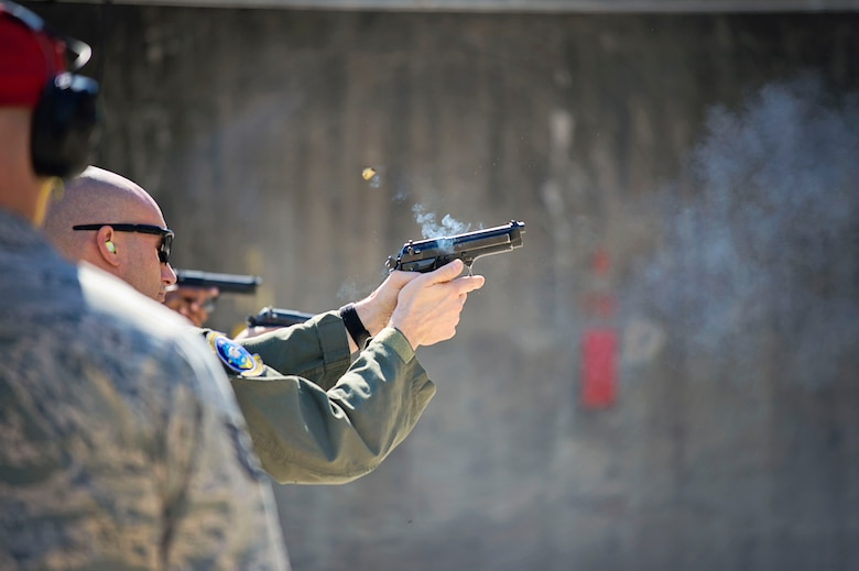 Master Sgt. Tim Morgan, a loadmaster with the 709th Airlift Squadron, fires his 9mm pistol down the firing range, April 1, 2016, at Naval Air Station Pensacola, Fla., as part of his weapons qualification training. Combat Arms reservists from the 512th Security Forces Squadron, from Dover Air Force Base, Del., trained the aircrews at the off-station event, March 29 to April 3, to ensure the safety a security of the reservists in future deployments. (U.S. Air Force Photo/Capt. Bernie Kale)