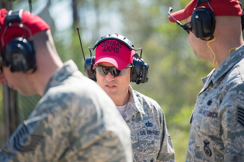 Tech. Sgt. Chris Wessel (center), a combat arms instructor for the 512th Security Forces Squadron, performs a safety evaluation with the other instructors on the firing range, April 2, 2016, at Naval Air Station Pensacola, Fla., as part of an aircrew deployment recurrency training event. Instructors from active-duty and Air Force Reserve and the Navy helped provided a seamless, multi-service cadre for the trainees March 29 to April 3, during the training event. (U.S. Air Force photo/Capt. Bernie Kale)