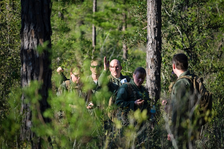 Reservists from Dover Air Force Base, Del., in the 709th Airlift Squadron, navigate their way through the swamps of Naval Air Station Pensacola, Fla., April 2, 2016, during their evasion portion of the combat training. The aircrews conducted an off-station training exercise, March 29 to April 3, to ensure they are current in all their deployment requirements. (U.S. Air Force photo/Capt. Bernie Kale)