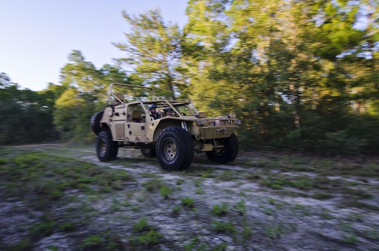The driver of a Guardian Angel Air Deployable Rescue Vehicle drives on the off-road trail while rescuing simulated escaped prisoners of war in the swamps at Naval Air Station Pensacola, Fla., April 2, 2016. Reservists from Dover Air Force Base, Del., in the 512th Airlift Wing's 709th Airlift Squadron, conducted an off-station training exercise, March 29 through April 3, to ensure they are current in all their deployment requirements. (U.S. Air Force photo/Capt. Bernie Kale