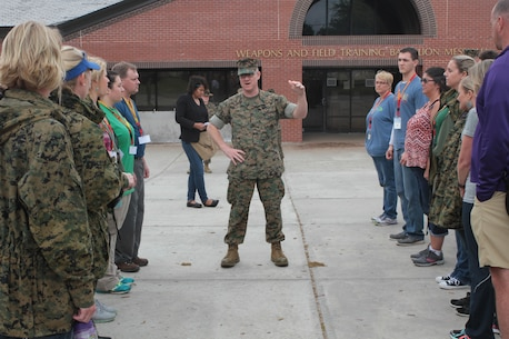 MGySgt Robert W. Haywood, Jr., speaks with the educators about the recruits they are about to meet and have lunch with April 13, 2016, at Weapons and Field Training Battalion Messhall aboard Marine Corps Recruit Depot Parris Island, S.C. As a part of the three-day workshop on Parris Island; counselors, teachers, and coaches are getting a taste of what it is to be a recruit as well as ask questions to better inform their students of opportunities in the Marine Corps. The educators are from Recruiting Stations Jacksonville and Montgomery areas. (Official Marine Corps photo by Cpl. Diamond N. Peden/Released)