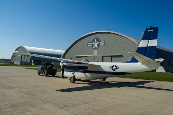 DAYTON, Ohio -- The Aero Commander U-4B being towed into the fourth building at the National Museum of the United States Air Force on April 12, 2016. This aircraft is one of ten Presidential aircraft in the collection. (U.S. Air Force photo by Ken LaRock)